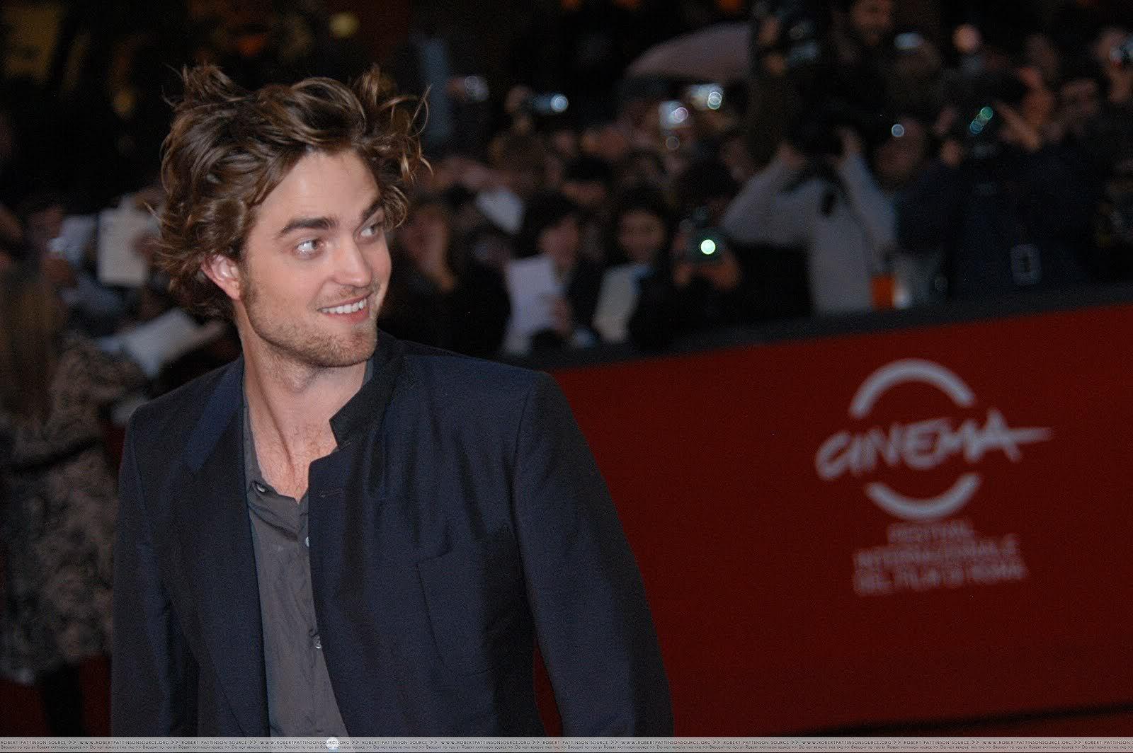 Robert Pattinson: Tema Principal - Página 5 Romesmile