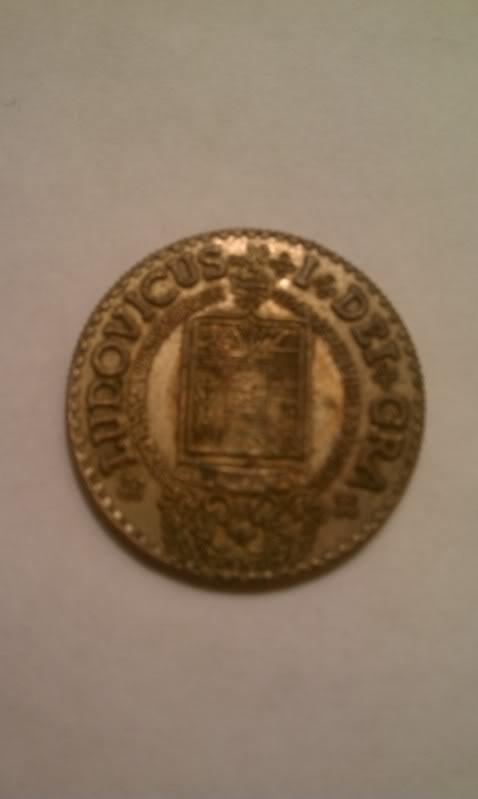1724, 4 escudos...Is this coin real and what's it worth?   IMAG0373