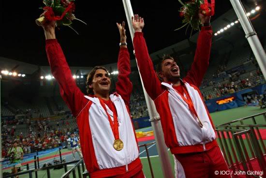 Stanislas Wawrinka y Roger Federer 885Y2278--IOC-John-Gichigi