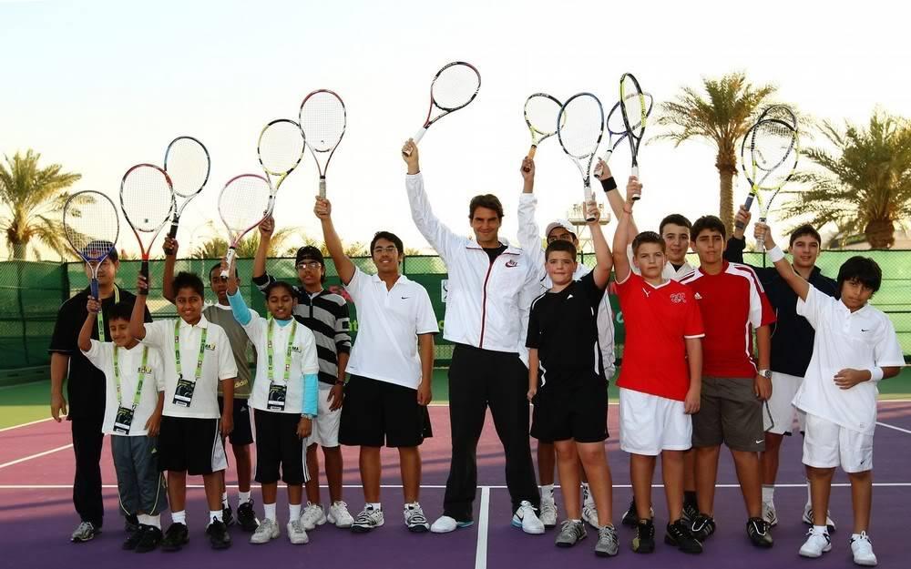 Roger y los niños Doha100104clinic07