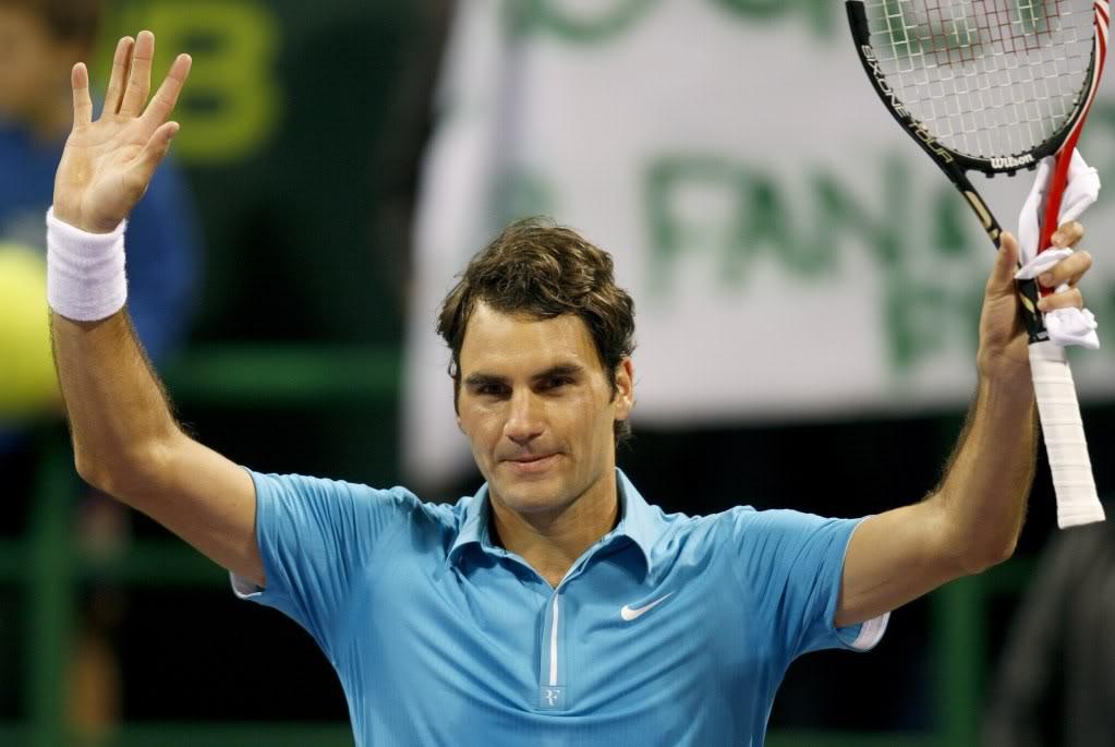 Votemos:¿Cual es la foto más sexy de Roger? - Página 3 Doha100107qfwave02