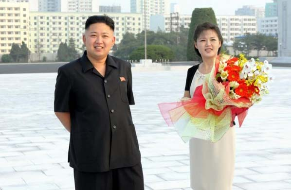 """KIM JONG-UNS WIFE IS A FORMER TRAFFIC GIRL! And the sister of recent """"Hero Of The Republic"""" recipient! Kim-jong-un-wife-ri-sol-ju-1-600x457AE_zps509012b1"""