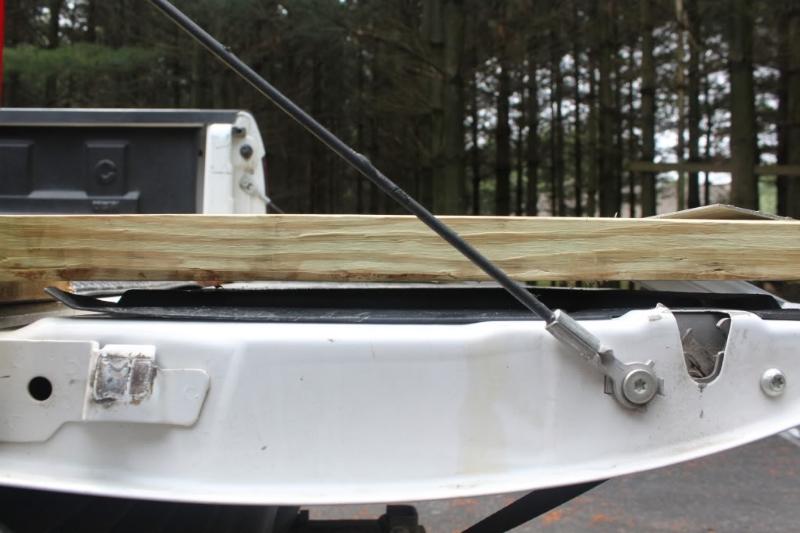 Hauling 900XP in truck bed C81aec61-0003-45b6-916e-cf1bd0a253fd_zps30f93640
