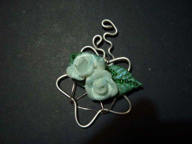 Stellina in metallo con rose DSCF2465