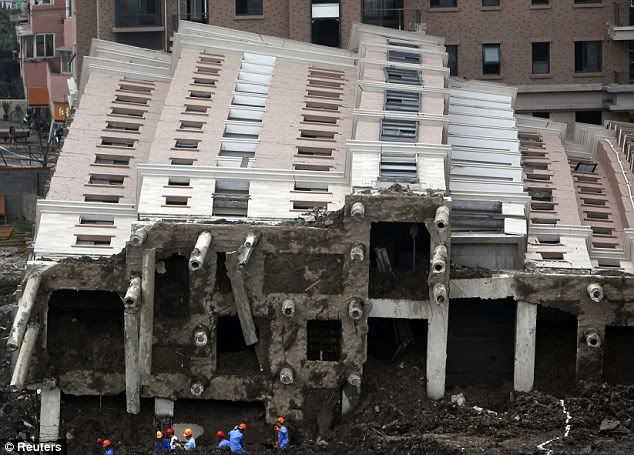 Nine people held after 13-storey block of flats collapses in China Article-0-0585E9B2000005DC-994_634x