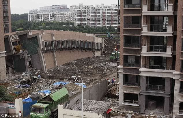 Nine people held after 13-storey block of flats collapses in China Article-0-0585EB53000005DC-784_634x