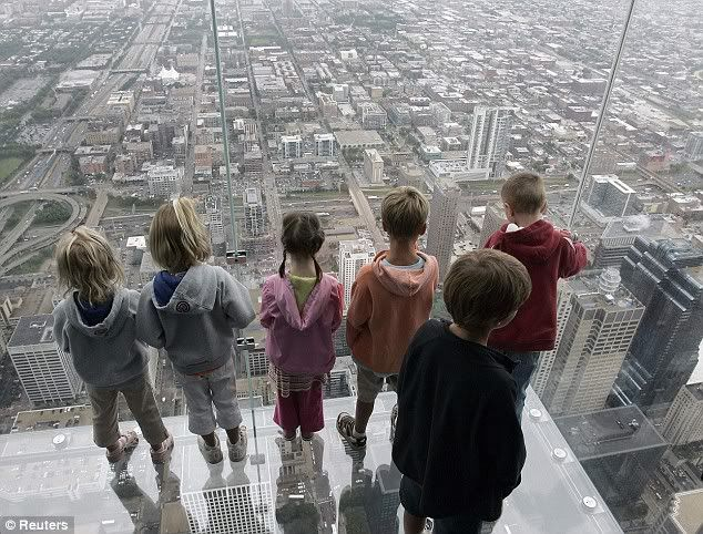 Don't look down: Terrifying view from glass box balcony jutting out from skyscraper's 103rd floor Article-1196967-058F9FB4000005DC-24
