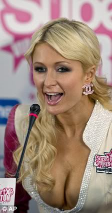 Paris Hilton tạo dáng sexy bên siêu xe 1292823041-parishilton5