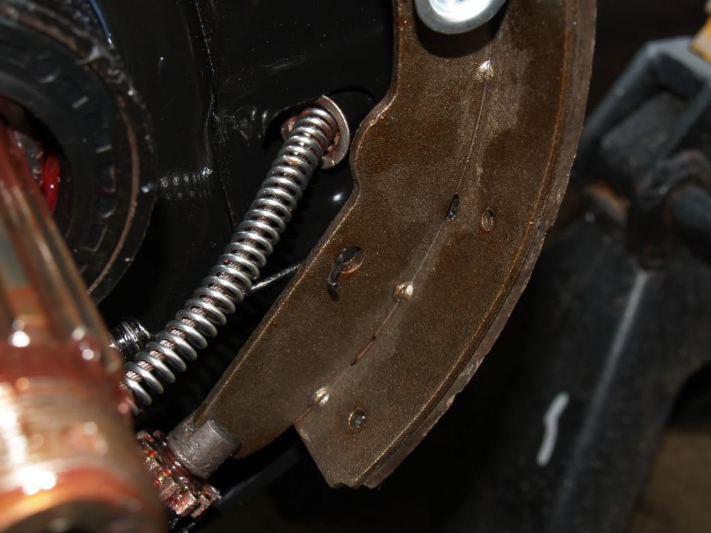 The Mystical little circlip for the e-brake line-71 bus!! SPRINGCUPOVERCABLEINPLACEBETWEENBACKPLATEANDSPRING-P2141205