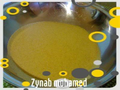 بالصور / طريقة تحضير الكسكسي الليبى   200810182405-001