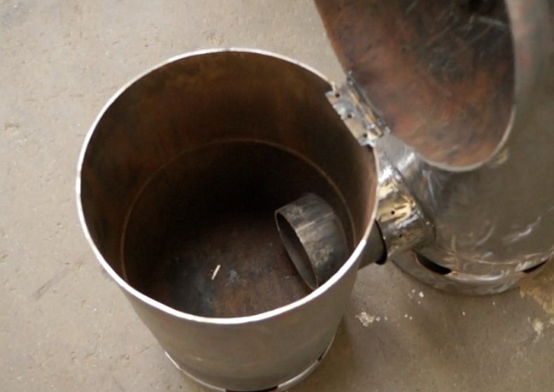 My first rocket stove space heater RS1_zpsbcea28b6