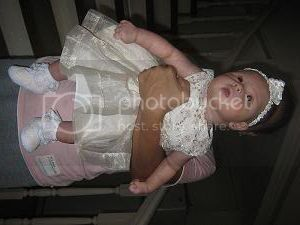 Paulo and Sally's daughter, Khen Eowyn, Christening Ke01