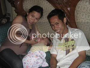 Paulo and Sally's daughter, Khen Eowyn, Christening Ke03