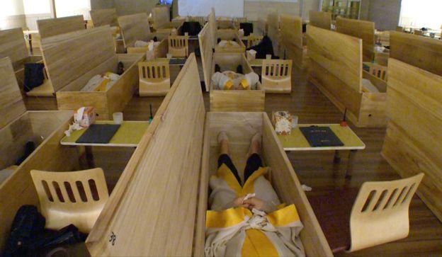 The employees shut inside coffins--  _86655692_lyingincoffins