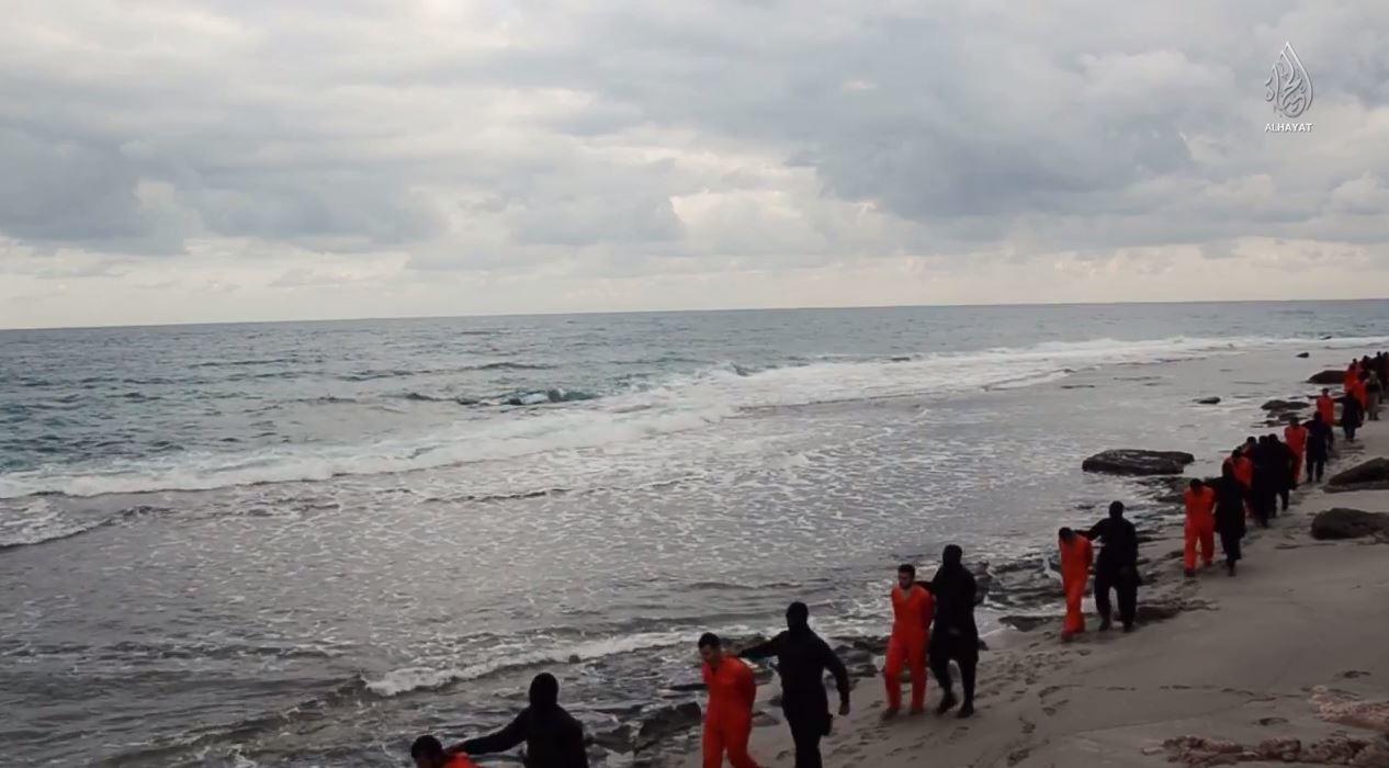 الوقائع الكاملة لأستشهاد 21قبطيا فى ليبيا على يد داعش 15/2/2015 1821871763