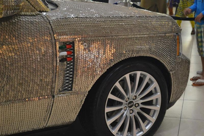 سيارة مرصعة بـ57412 عملة معدنية في دبي  0013729e7972143dc10307