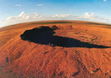 New analysis just changed the original date of a massive meteorite crater in Australia Brown_land_470-420x0