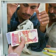 Investors in new Iraqi dinar spur thriving Web trade Iraq-dinars