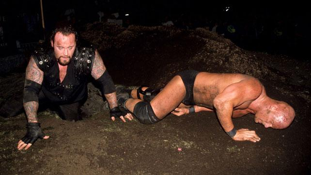 Historic Old School Wrestling Images Undertaker_vs_stone_cold_buried_alive_at_rock_bottom