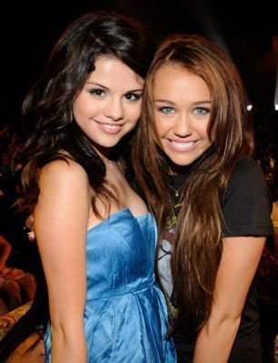 We together       Miley-Selena-miley-cyrus-vs-selena-gomez-2026377-306-400