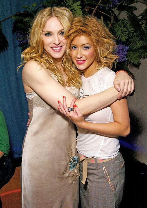 Samples utilizados en canciones de Christina Christina-Madonna-together-backstage-during-Madonna-s-04-Re-Invention-Tour-christina-aguilera-12625641-509-719