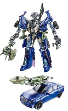 Q&R: Parlons de robots TF | TF sont bio-mécaniques ou mécanique? | Sideshow | Échelle des jouets | etc - Page 10 Dotm-wheeljack-toy-deluxe