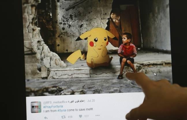 phénomène mondial  648x415_un_journaliste_montre_le_montage_d_un_artiste_syrien_alliant_guerre_en_syrie_et_pokmon_go__beyrouth_le_22_juillet_2016