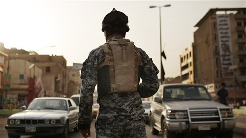 What is this camo AFP_110724_c90l8_irak-policer_8