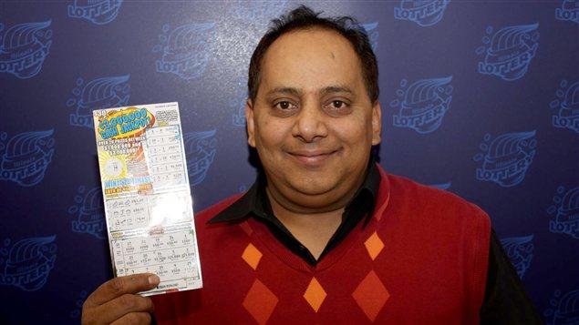 Prier pour gagner à la loterie est-ce permis selon vous ? - Page 3 AFP_130112_252ot_gagnant-loterie_sn635