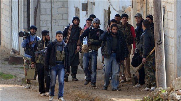 """Terrorisme à """"visage humain"""": L'histoire des escadrons de la mort des États-Unis AFP_130128_wj3ee_rebelles-syrie_sn635"""