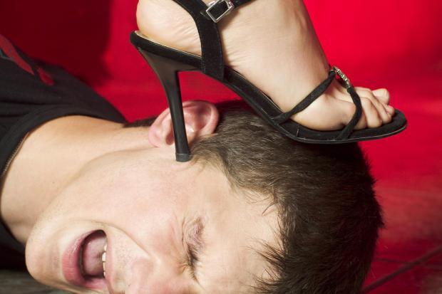 Interesante me fantazi Close-up-of-woman-dominatrix-in-high-heeled-sandal-stepping-on-man-s-head