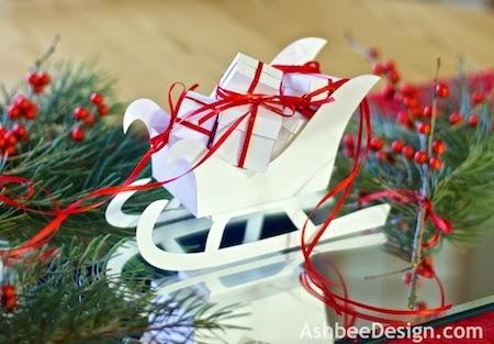 Новый год и Рождество.Декор 107750592_Severnuye_oleni_i_sani_s_novogodnimi_podarkami_iz_bumagi_SHablonuy__3_