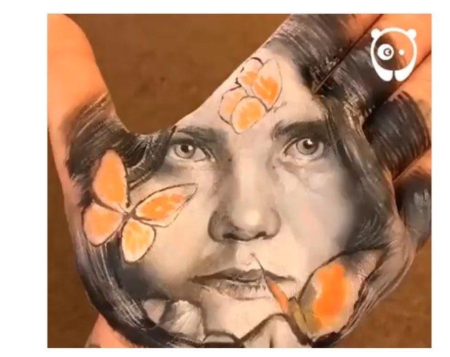 رسام إيطالي يبدع لوحات رائعة على راحة يده 1385436769