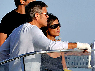 George Clooney and Stacy Keibler in Venice.....always on the boat.... Clooney-hand-320