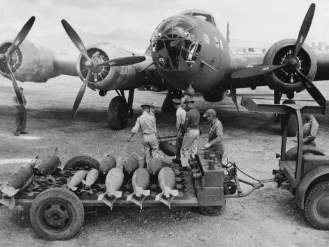 Surviving the Winter Wasteland! February Bombing Run!  - Page 2 Ordnance-crew-loading-300-pound-bombs-into-a-u-s-air-force-bomber-hawaii-1942