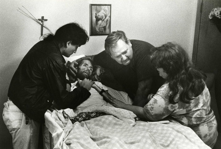 The Shocking and Bizarre 33.-Widely-considered-the-photo-that-changed-the-face-of-AIDS-A-father-comforts-his-son-David-Kirby-on-his-deathbed-in-Ohio.-Published-in-LIFE-magazine-November-1990.-720x486