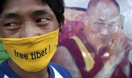 Marche du Dalaï Lama/Lhassa s'enflamme, Pékin l'étouffe - Page 16 20080311t064844z01nootrrtridsp2ofrwrchinetibet20080311
