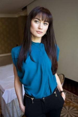 Украинские знаменитости - Страница 4 1334234061olga-kurilenko-bez-fotoshopa
