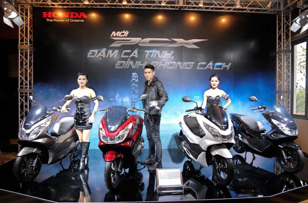 Moto para o meu pai.. o que fazer? Honda-vietnam-launchs-pcx-125-03