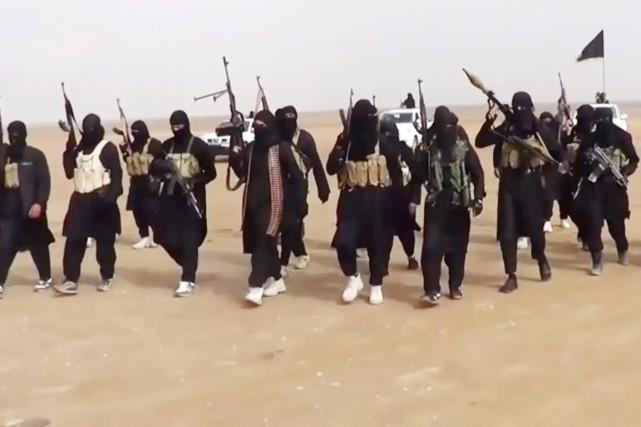 Irak et Syrie ou l'arnaque occidentale de l'EI  866778-militants-etat-islamique-irak-levant