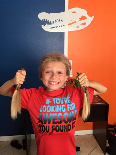 This 8-Year-Old Was Bullied While Growing His Hair – To Make Wigs For Kids With Cancer Holding_pony_tails_895d69e8b9d1bc3ee1cb886b9246f441.today-inline-large