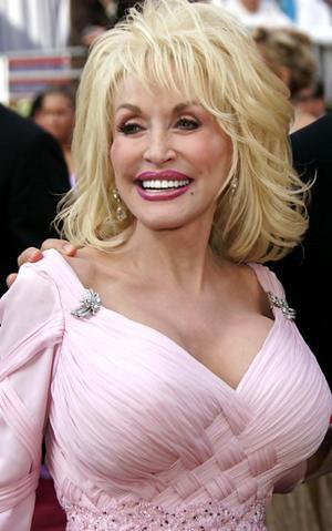 Personnes célèbres réelles ou imaginaires - Page 38 Dolly-parton
