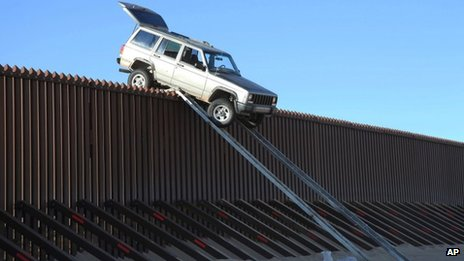 Mexico 'smugglers' car' gets stuck atop US border fence _63855400_63854030
