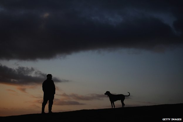 Why do mornings still get darker after the winter solstice? _79847555_man-and-dog