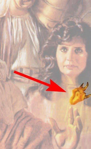 Immagini subliminali a tema satanico nella Torre di Guardia 6hjj1u