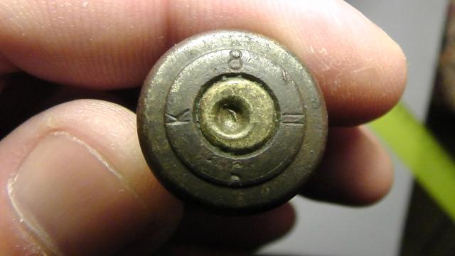 Гильза и пуля патрона 10.75x58 R 11r80f8