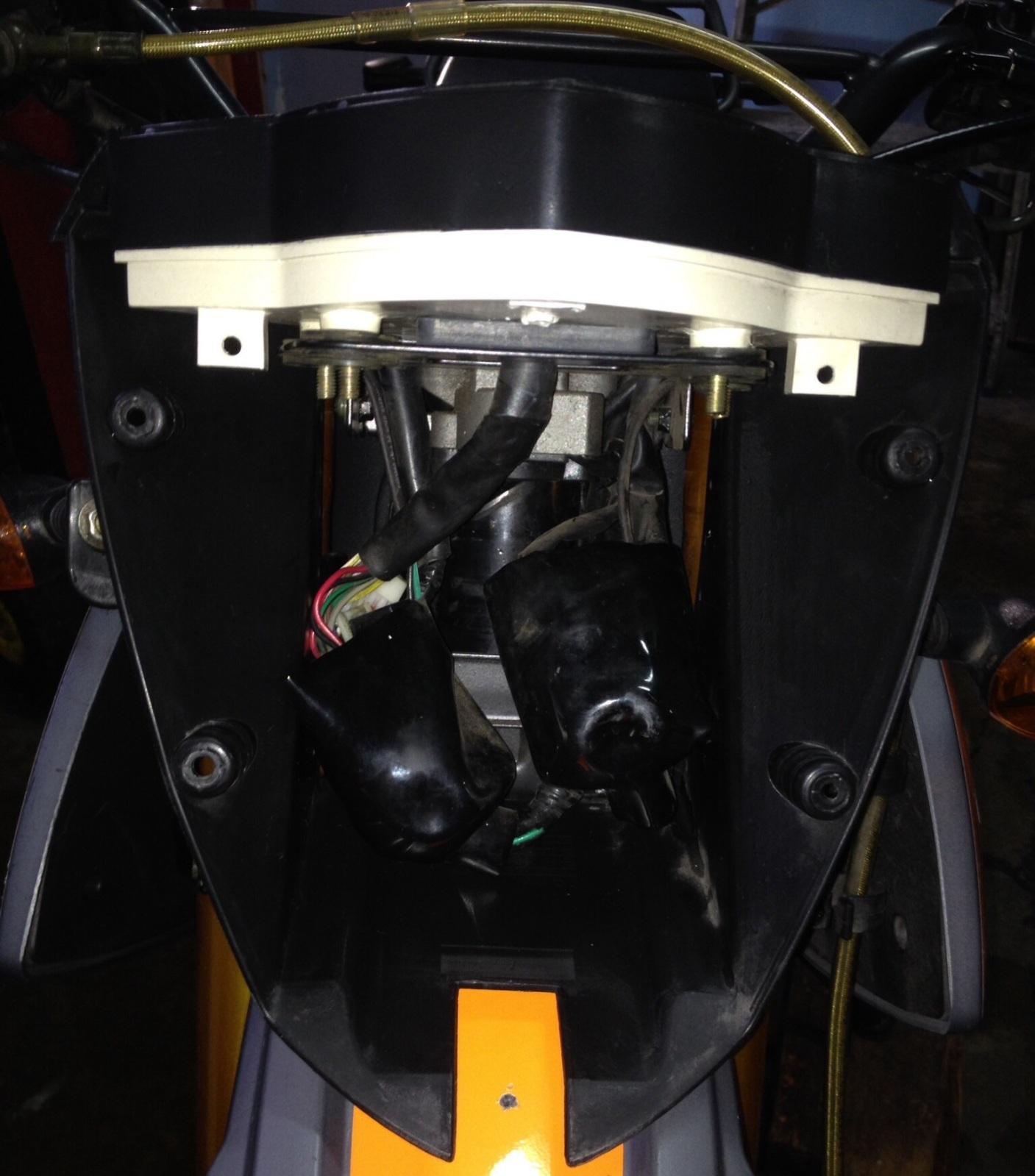 Cambiar Bombilla de Faro Delantero de TX 200 350785d
