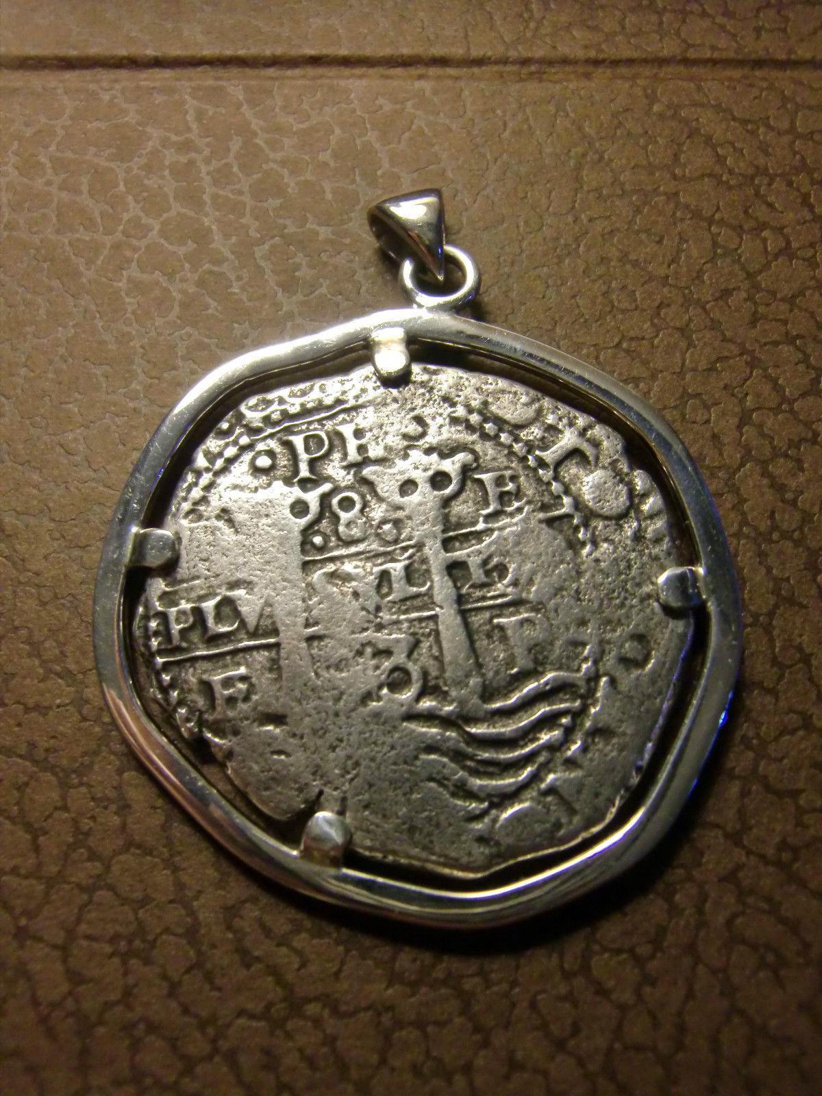 8 reales de Felipe IV, procedentes buque Capitana. Swpbms