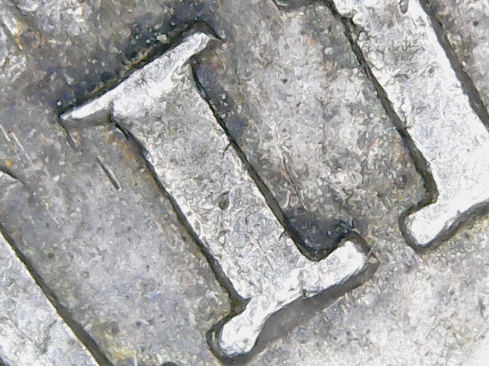 Resultados de un microscopio USB: detalles de las monedas  2kfub4
