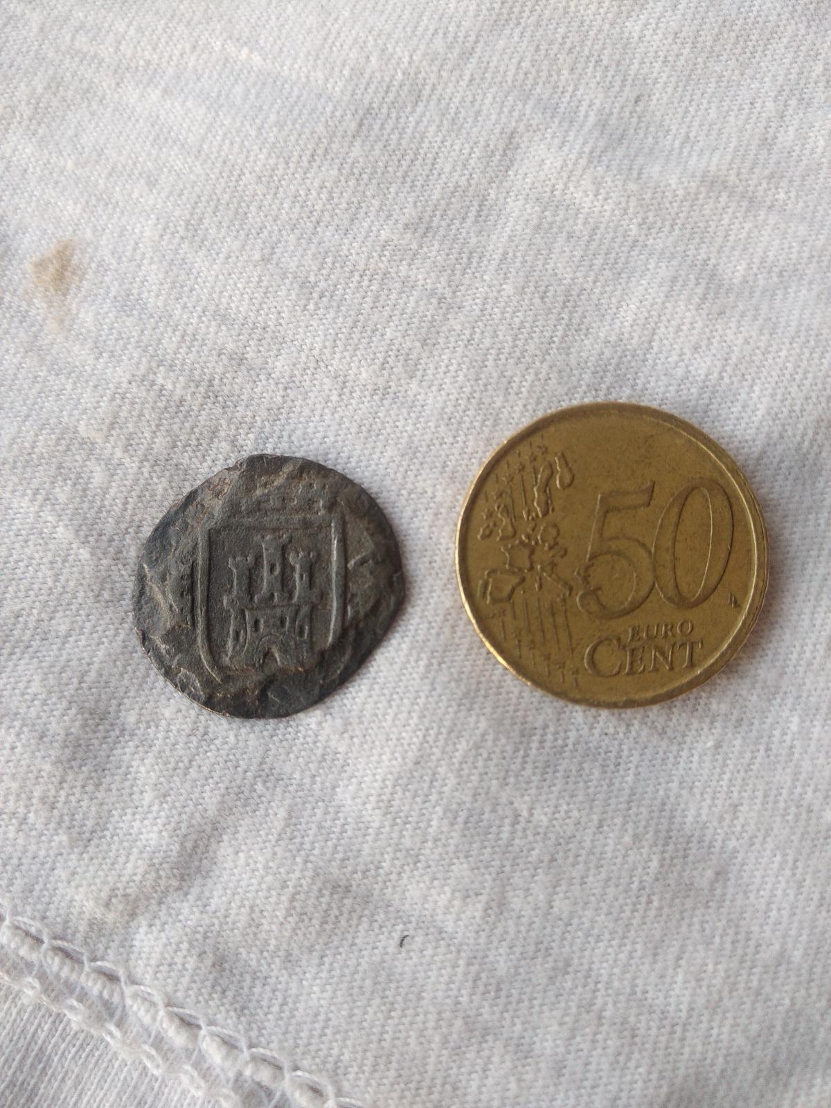 moneda ? con dos escudos Ojgua9